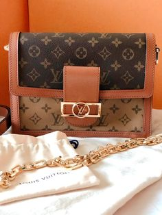 As soon as I laid my eyes on the Louis Vuitton DAUPHINE MM from the collection, I fell instantly in love. Dubbed the new 'IT' bag of the season, I was super fortunate to get my hands on this must-have luxury handbag, as soon as it was released. Luxury Handbags, Designer Handbags, Classic Handbags, Calf Leather, Louis Vuitton Monogram, Calves, Purses, Dubai Life, Vuitton Bag