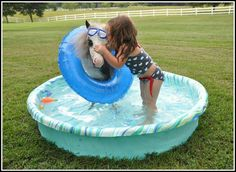 Little girl with her pony in a pool