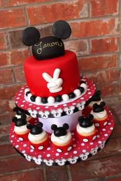 Like the Cake with cupcakes under it. I would rather see a number than the fingers and the cupcake toppers could be much simpler than that... maybe just mini oreos for ears or something.  I do like the idea of a mouse hat with his name on it for the top of the cake.
