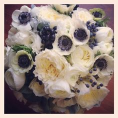 Designed by Bella Fiori. Viburnum dentatum, Blue Muffin and Ligustrum vulgare, common name is Privet combined with garden roses and dark-eye anemones.