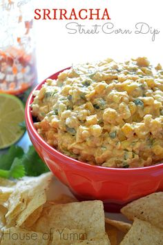 This Mexican Street Corn Dip #recipe is spiced up with a little #Sriracha! Perfect dip to set out for guests, bring to a #potluck, make for football games, or to just snack on!