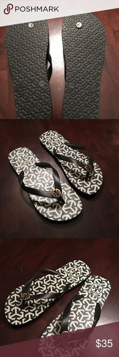 Tory Burch Flip Flops New without Tags, never worn. Black, Gray and white flip flops. With a gold Tory Burch embellishment. Tory Burch Shoes Sandals