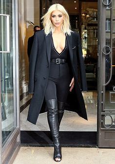 After her unusually modest pinstriped suit on Monday, March 9, Kim Kardashian returned to her boob-baring ways with an ultra-sexy outfit on Tuesday, March 10.