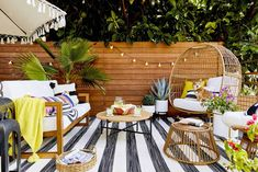 Transform your outdoor space with advice from these 9 top designers. From growing a vertical garden to choosing comfortable furniture, this is how to make your space feel super zen. Outdoor Pouf, Outdoor Cushions, Outdoor Dining, Outdoor Spaces, Outdoor Decor, Outdoor Seating, Outdoor Ideas, Back Patio, Small Patio