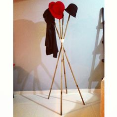 a coat / hat rack i DIYed using bamboo laundry poles tied together with some leftover yarn i found in the craft drawer. heh. total cost, $6! =)