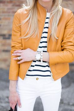 Beautiful cognac almost orange leather jacket paired effortlessly with a striped top and white denim