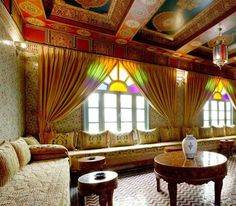 Moroccan decorating ideas, beautiful Moroccan rugs, luxurious home decorating fabrics, Moroccan poufs made of leather or fabric, Berber desert lanterns, unique Moroccan decorations for walls and house plants, add texture, bright colors and softness to traditional or modern Moroccan decor