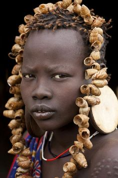 Ethiopia. Mursi girl, Omo Valley, Ethiopia // © Peter Adams / Jon Arnold Images