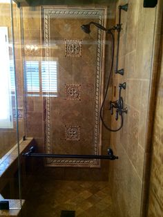 Another beautiful design and installation by 714 Flooring Inc. Anaheim Hills CA. I love this master shower. I used chocolate chiseled edge Versi patterned travertine with Encore crushed glass custom decos. Love how it turned out!