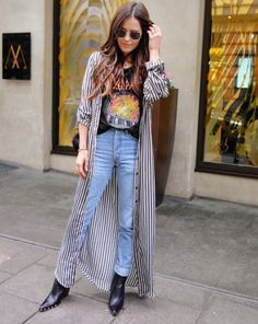 Undo the buttons of your striped duster and layer it with a band tee and jeans