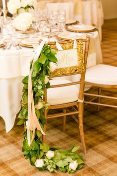 Gold framed Mr. + Mrs. Signs on Gold Chivari Chairs with Roses + Greenery | Elegant Gold + White Wedding at Sea Pines Country Club by Charleston wedding photographer Dana Cubbage Weddings