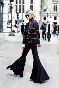 If you want to create a similar look, start off with a leather jacket or moto jacket and combine it with flared bottoms.