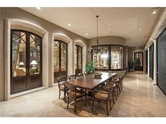 Estates at Bay Colony Golf Club | Outdoor dining on the screened lanai | luxury custom golf estate