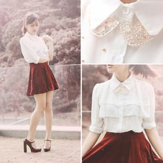 velvet red skirt with a white ruffled shirt and a detailed collar necklace