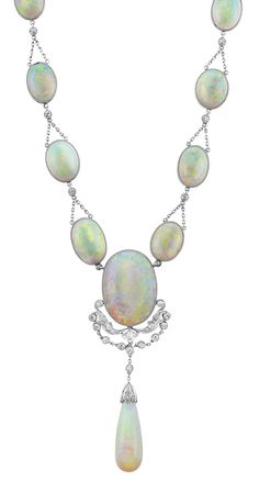 Platinum, Opal and Diamond Necklace. One oval opal ap. 15.50 cts., one round & 16 oval opals ap. 54.00 cts., one drop-shaped opal ap. 24.0 x 9.0 mm., c. 1910.
