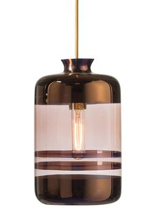 The Pillar lamp is produced in mouthblown glass, featuring beautiful metallic copper stripes on a transparent copper-coloured glass.   The lamp is delivered with brass metal fitting and 2m round gold wire.  32cmH Ø19cm  Suits E27 light bulbs, for instance the 00540 Tube filament light bulb. www.houseofbk.com