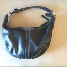Black COACH Hobo Purse Black Coach hobo purse. Excellent used condition. The place where the buckle slips in is broken. Shown in the 2nd picture. I bought it this way and had planned to get it fixed at a leather store and never got around to it. I carried it this way and it never bothered me. Coach Bags Hobos