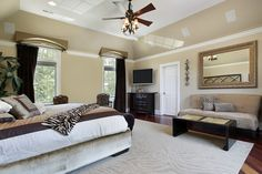 Master bedroom with tray ceiling and patterned rug