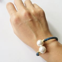 Blue twisted pearl bangle on TROVEA.COM