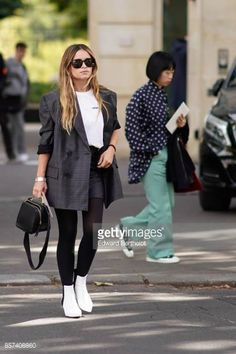Miroslava Duma wears a blazer jacket outside Miu Miu during Paris Fashion Week Womenswear Spring/Summer 2018 on October 3 2017 in Paris France