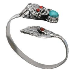 Turquoise White Metal Raging Dragon Bracelet Om Tibetan Jewelry. $24.99. Handmade in Nepal. Made from Alloy. Turquoise Inlaid. Adjustable Size: One Size Fits All. Width: 0.25 Inch