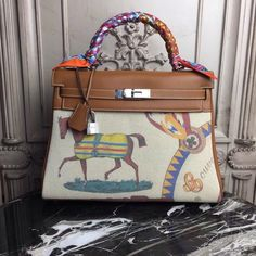 Hermes Gold Kelly 32cm Togo Palladium Hardware by Bella Vita Moda Personalization For sale at  http://www.bellavitamoda.com #hermes #hermesbirkin #hermeskelly #hermesbag #hermesbuyer #baglover #bagaddict #onlineshopping #fashionistas