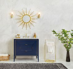 The gorgeous Amora Vanity in Navy paired with our Sunburst mirror in Polished Brass is a perfect combination.