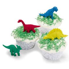 Dinosaur cupcakes. I'm going to use brown kraft cupcake liners and crushed graham crackers on top rather than coconut (my boys wouldn't eat their own cake if I used coconut!).