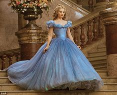 British actress Lily James dons Cinderella's iconic icy-blue dress in the latest Disney movie... Which I absolutely loved!!!