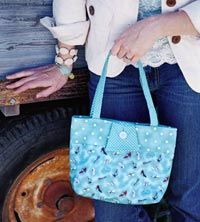 Signature Style Tote tutorial.  Another great bag to whip up with your favorite fabric.