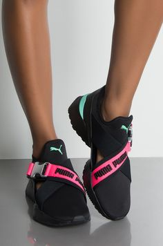 Front View Puma Womens Muse Eos Street 1 Sneaker in Puma Black Knockout Pink Be sleek, sporty and sexy. The PUMA Women's Muse EOS Street 1 Sneaker has the edge you need to amp up your streetwear game. A tight knit lycra material encompasses the base of Cute Sneakers, Casual Sneakers, Sneakers Fashion, Shoes Sneakers, Women's Shoes, Fresh Shoes, Hot Shoes, Pumas Shoes, Nike Shoes