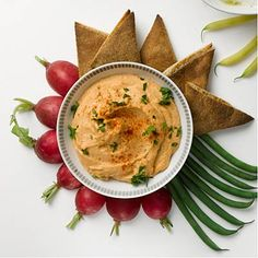 Red-Lentil Hummus: Lentils are loaded with filling fiber and protein, so just a little will go a long way in keeping you full. Enjoy this dip with raw broccoli or toasted whole-grain pita wedges. | Health.com