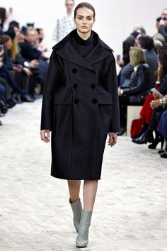 """FALL 2013 READY-TO-WEAR Céline / """"I really went on instinct and desire,"""" said Phoebe Philo after her supremely elegant Céline show, """"if I can create any kind of desire, that's great."""" In what was certainly one of the most desirable collections of the season, Philo moved away from the now-iconic linear Céline aesthetic (which continues to influence countless less imaginative international runways) and into clothing with a gentle swing of movement or great, rounded volume."""