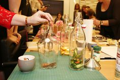 Step 2 of @Michelle Edgemont's Infused Vodkas: Place the ingredients inside the bottles. #pinspirationparty