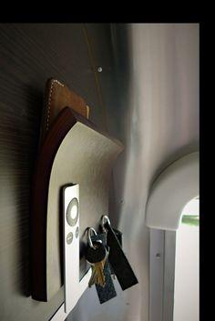 A safe place for our keys, remotes, wallets and more.  Umbra Magnetter