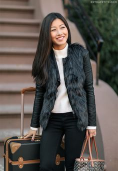 Layering a faux fur vest over a leather moto jacket for a new look