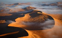 Cloud City - An unbelievable misty morning above the intricate dunes of the Namib Desert. Shooting from a helicopter provides an astonishing angle of view on the world's largest dunes. We were nearing the point where we were supposed to head back when the pilot spotted the mist. It wasn't a very hard decision to go on for twenty more minutes! :) Join me to shoot this amazing place, among many others, on the '<a…