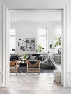 Two vintage Spanish Chairs caught from behind in the home of Swedish interior stylist Lotta Agaton. Image via Photo by Petra Bindel for Åhléns My Living Room, Home And Living, Living Room Decor, Living Spaces, Cozy Living, Dining Room, Living Room Inspiration, Interior Inspiration, Style Californien
