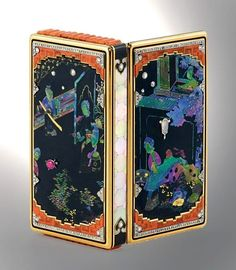 An Art Deco gold, platinum, lacquer, enamel, ruby, coral, Mother of Pearl, moonstone and diamond Vanity Case by CARTIER, circa 1927