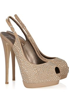 GIUSEPPE ZANOTTI  Embellished suede and leather slingbacks.  Dazzled in light-catching crystals, Giuseppe Zanotti's nude suede and leather slingbacks are an enchanting example of the label's signature high-glamour style.