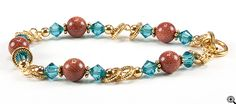I love this color combo.  Goldstone with Indicolite bicone crystals. Goldstone Canyon Bracelet (eebeads.com)