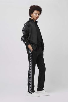 Channel off-beat cool in this complete tracksuit by Kappa. Crafted in a soft polyester, it features an all-over sleek black finish completed with contrasting branded white edge taping to the sleeves and leg. #Topshop