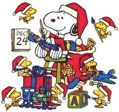 Santa Snoopy and his elves.  So cute!