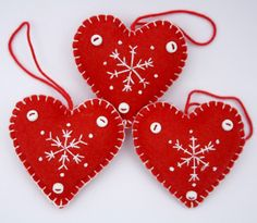 Felt Christmas Heart ornaments,Handmade red and white snowflake hearts,Set of 3 Scandinavian embroidered heart decorations, by PuffinPatchwork on Etsy https://www.etsy.com/listing/85893839/felt-christmas-heart-ornamentshandmade