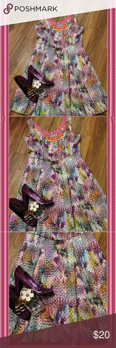 """New York and Company Multi Color Dress Step into Spring.. Easter perfect.. Like a colorfully decorated easter basket. Mesh fit and flare. Almost any cardigan color, shoe color would match. Such a fun, happy dress. Pit to pit 19.5 Waist 17"""" Length 39"""" Front side measured. New York & Company Dresses Asymmetrical"""