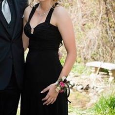 All black Cache dress with silver accent open back Worn once for Prom and don't need it is very comfortable. I am a size 6 but the four fits me perfectly also it fit my friend who's a size 2! Cache Dresses Backless