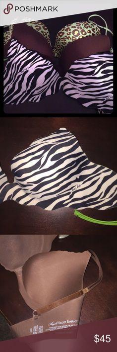 Victoria's Secret bras 34 B bundle Worn once. 1 scalloped zebra Very Sexy 34 b     1 lime green cheetah Very Sexy 34 b and 1 brown scalloped Angels Secret Embrace 34 b. Sold as bundle of 3 Victoria's Secret Intimates & Sleepwear Bras