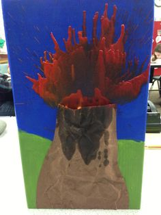 Volcano art project with melted crayons