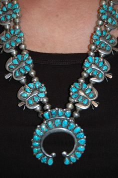 Stunning Old Pawn Zuni Sterling Natural Turquoise Squash Blossom Necklace w earrings. While usually associated with Navajo silversmiths, squash blossom necklaces are also made and worn by Pueblo and Zuni people. Zuni necklaces usually feature needlepoint designs.