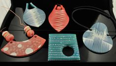 Polymer clay pendants   Playing with layers. I am sort of stuck right now and decided to explore using layers.